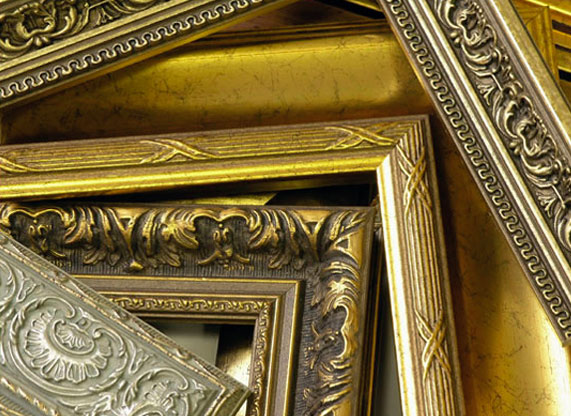 custom framing golden frames stacked on top of each other abstract photo shot